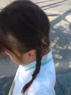 おさげ髪。